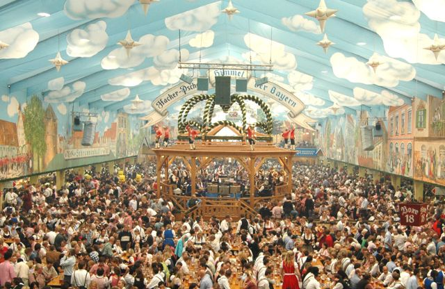 It truly is the heaven of the Bavarians the Hacker Festzelt. With its famous white and blue ceiling which was designed by Oscar winner Rolf Zehetbauer and ... & Oktoberfest Beer tents