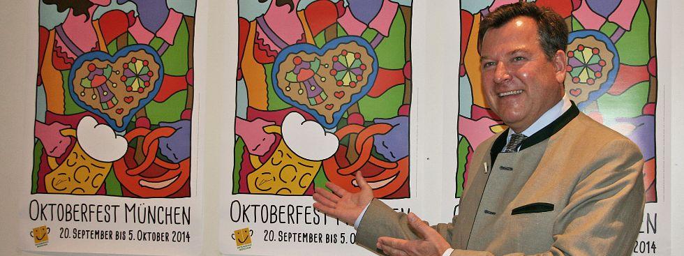 Oktoberfest Pressekonferenz 2014: Bürgermeister Josef Schmid vor dem Wiesnplakat, Foto: Melina Pfeffer