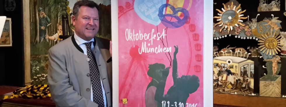 Bürgermeister Josef Schmid mit dem Oktoberfestplakat 2016, Foto: Leonie Liebich