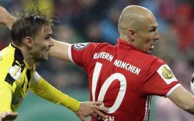 Marcel Schmelzer und Arjen Robben im Zweikampf.